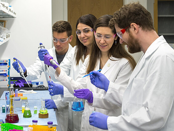 Students in the lab in the Michelson Center for Convergent Bioscience.