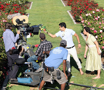 Students film in the Rose Garden.