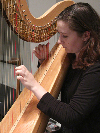 Music student plays the harp.